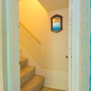 Entrance through upper apartment