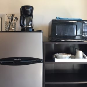 Mini fridge and freezer, microwave, coffee maker, and dishes for your use