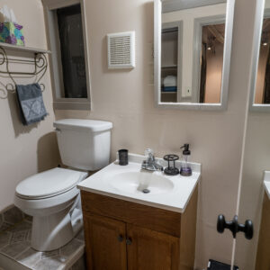 Fully equipped bathroom with small linen closet
