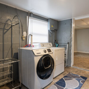 Free laundry area in entrance to apartment