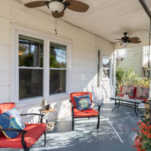 Shared front porch with furniture, fans, and sun shades