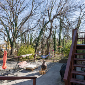 Shared back patio with fire stove, grill, eating areas, and hammocks